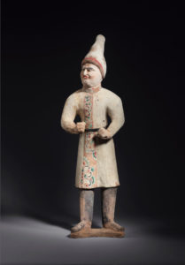 Pottery figure of a foreign groom with a pointed hat, Height 65 cm, China, Tang dynasty, 7th-8th century Ben Janssens Oriental Art Ltd © Chinese and Japanese works of art